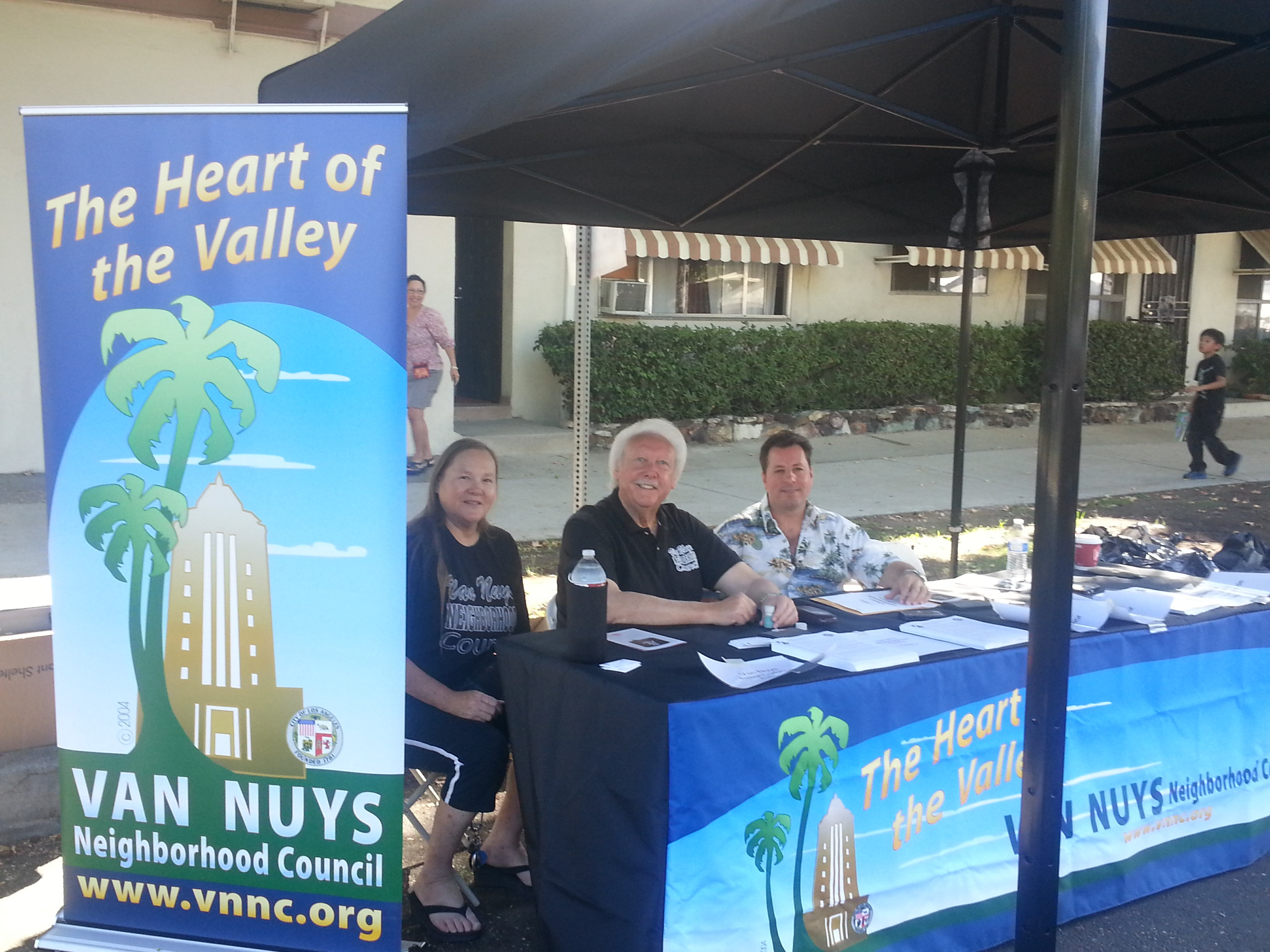 VNNC board members Jeanette Hopp, Howard Benjamin and John Camera with the new VNNC canopy and table