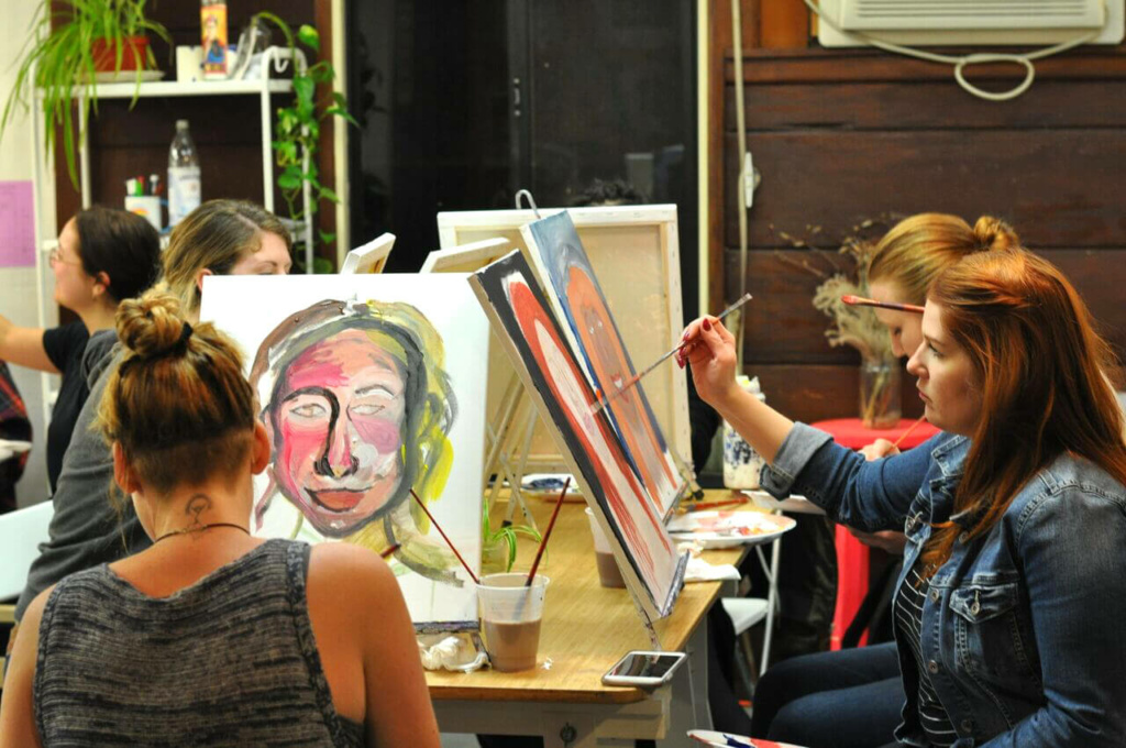 Women painting art on canvases