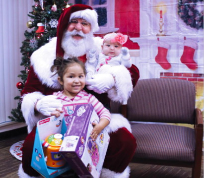 Santa with two children and toys