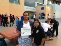 Maria Skelton receives certificate for her volunteer work
